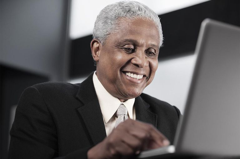 Black businessman using laptop