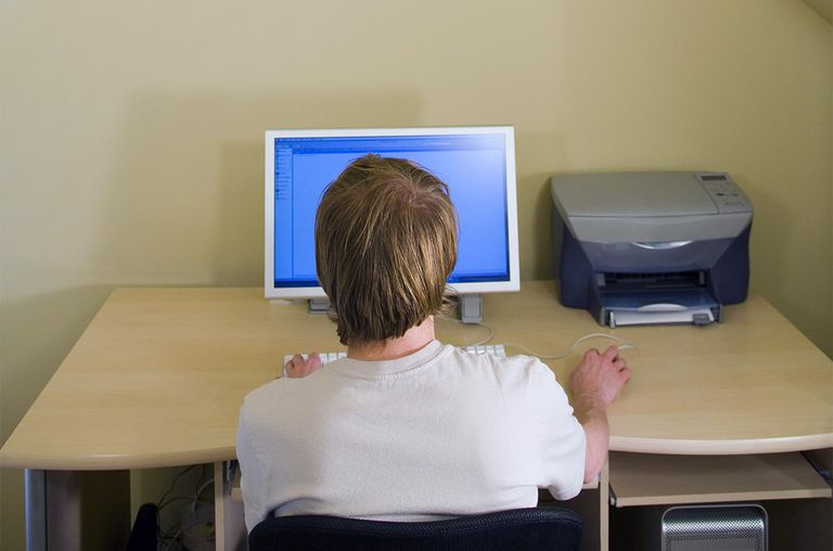Man using computer, rear view