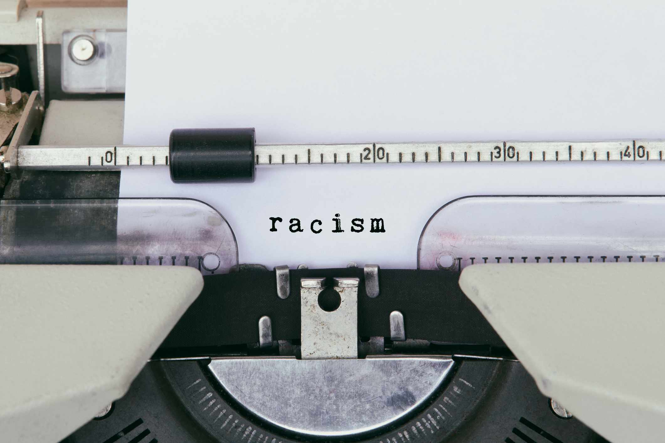 Racism typed on a page in a vintage typewriter.