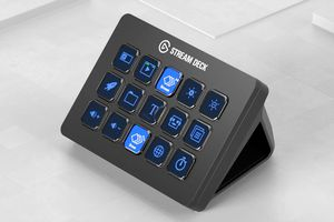 Elgato Stream Deck in black with blue keys sitting on a white desk