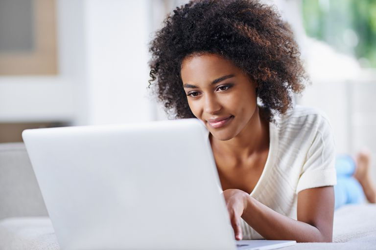 Young woman using her laptop.