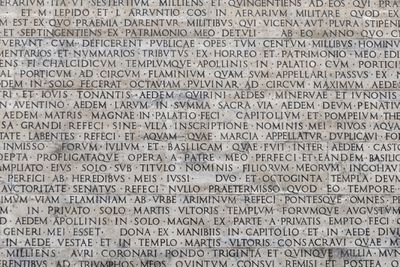 Latin words carved into marble.