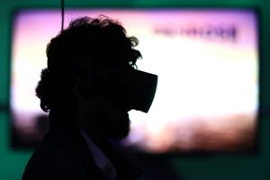 Silhouette of man with VR set on head