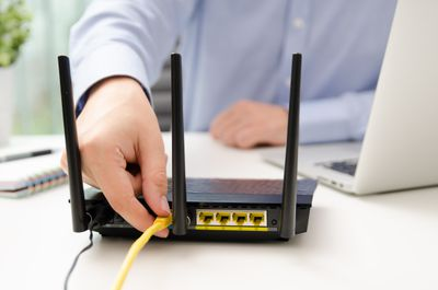 A man works on his router.