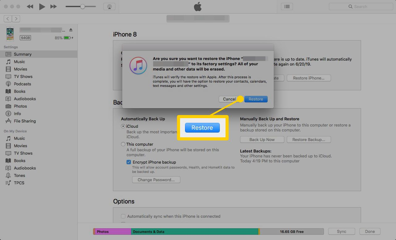 iPhone restore confirmation screen in iTunes with the Restore button highlighted