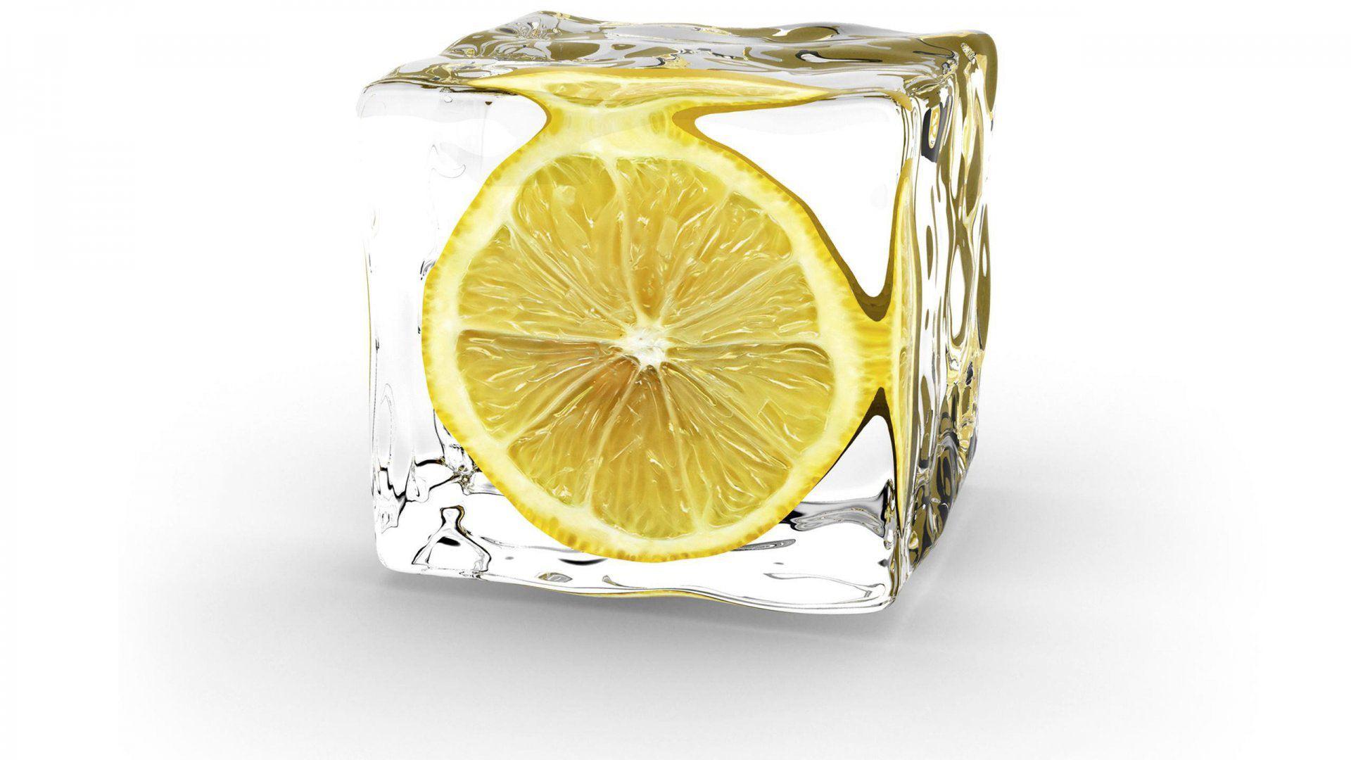 Wallpaper background of lemon slice frozen in an ice cube