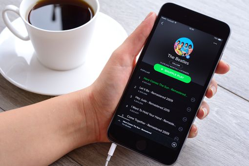 A person using the Spotify Music app on their smartphone.