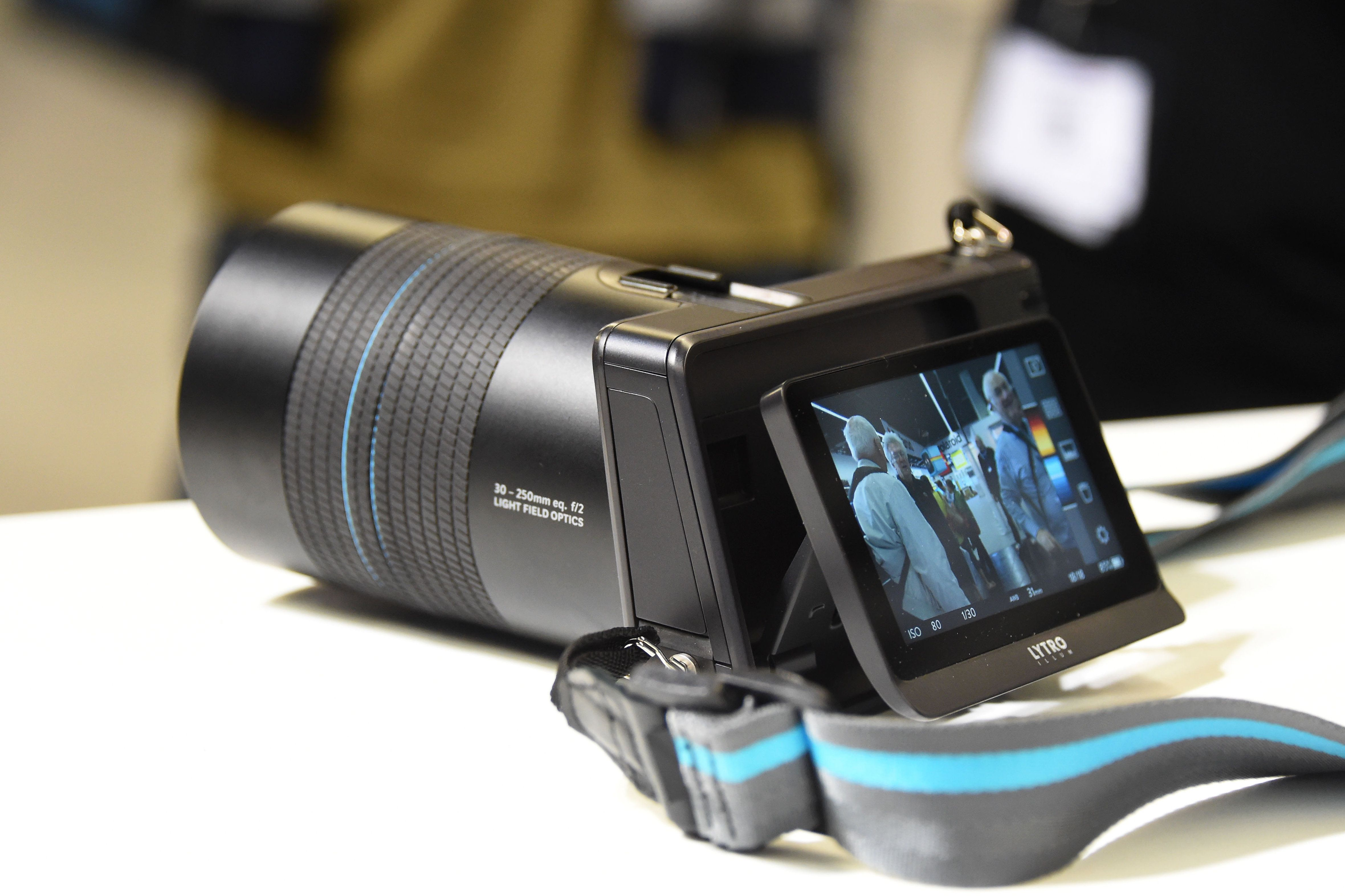 Lytro camera with strap on a white table
