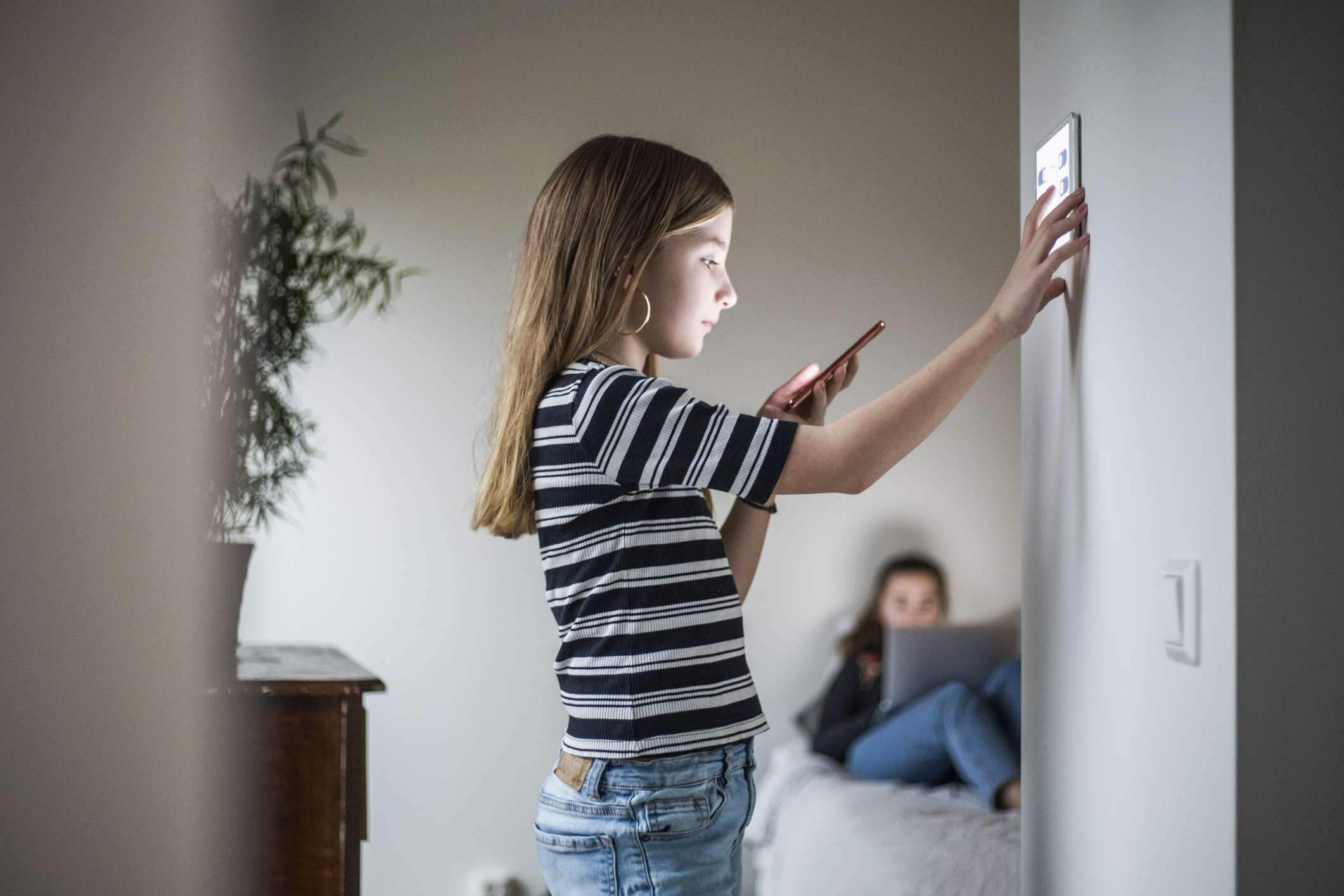 Girl at wall mounted display