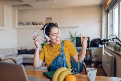 Young woman listening to music and enjoying at home after work.