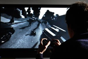 A young man plays Grand Theft Auto IV on the game's day of release