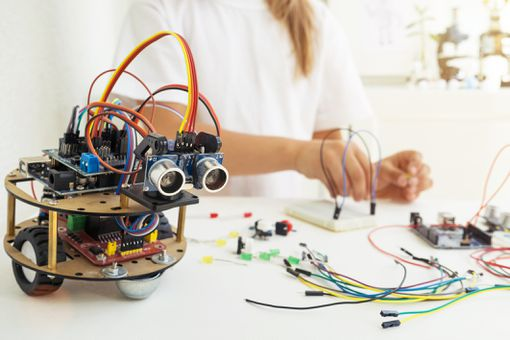Girl building an Arduino robot