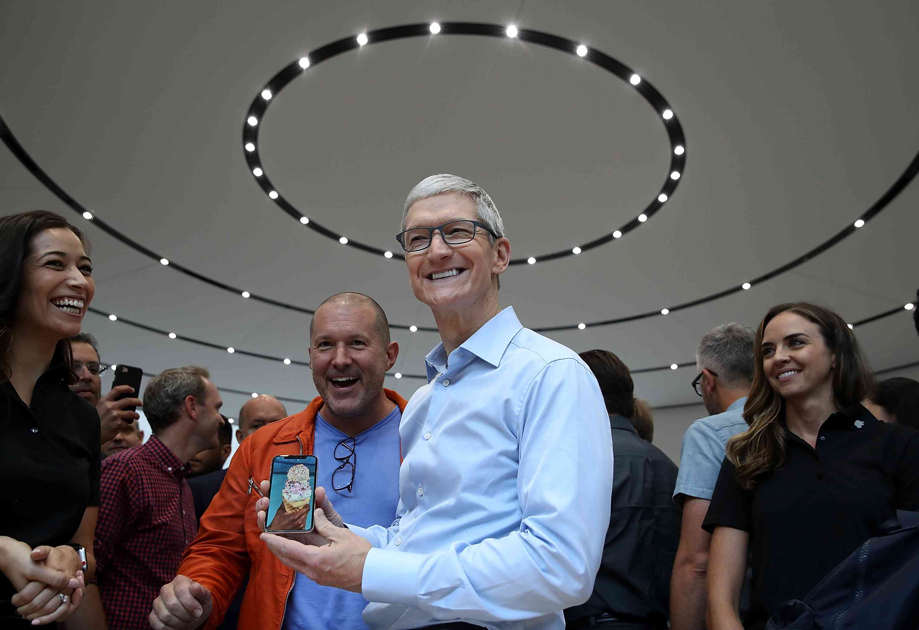 Tim Cook and Jony Ive show off the iPhone X.