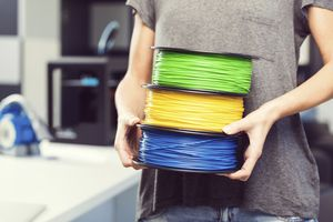 Picture of someone carrying spools of filament