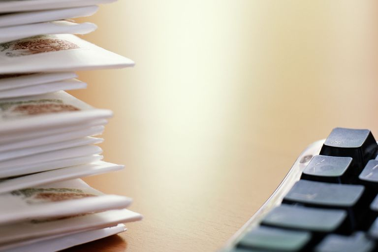Pile of post by keyboard, close-up