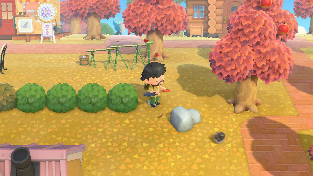 Animal Crossing character swings at a rock