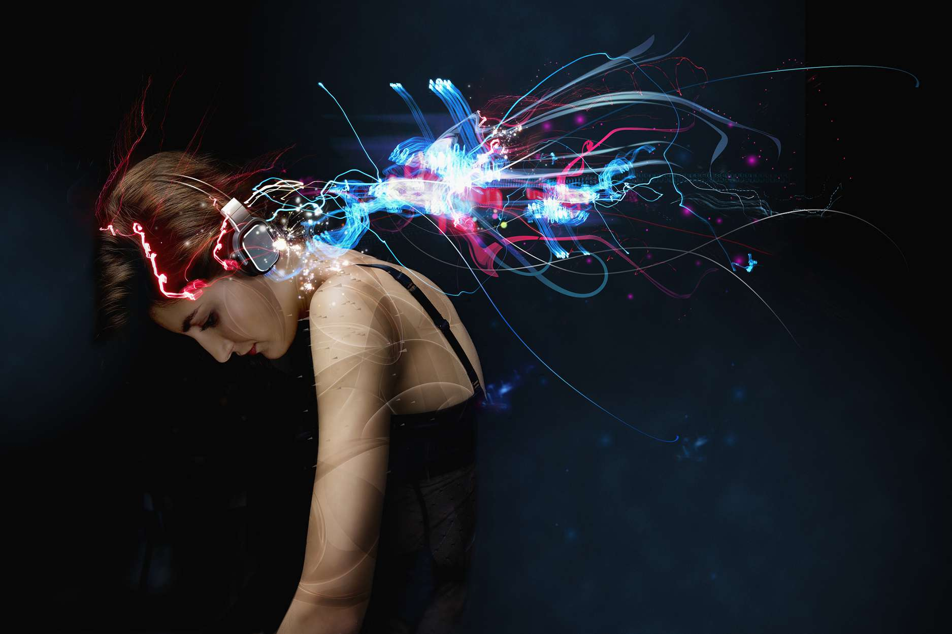 A photo illustration of a woman wearing headphones while streaked lights is drawn around her.