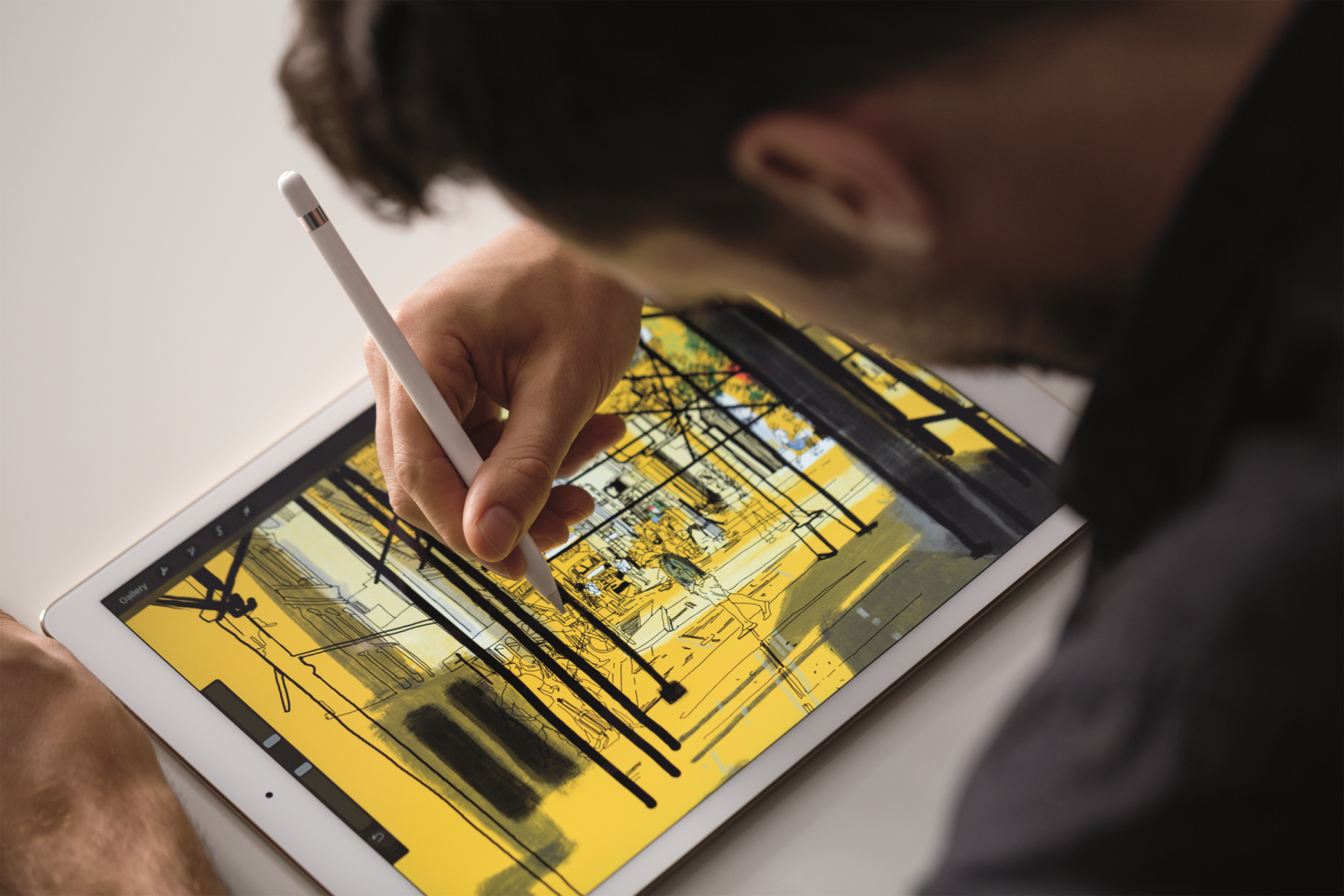 A person using an Apple Pencil on an iPad Pro