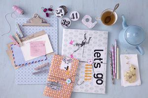stationery items, teapot and cup, clipboard, cookies
