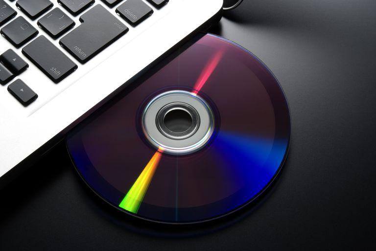 DVD inserting into a laptop optical disk drive
