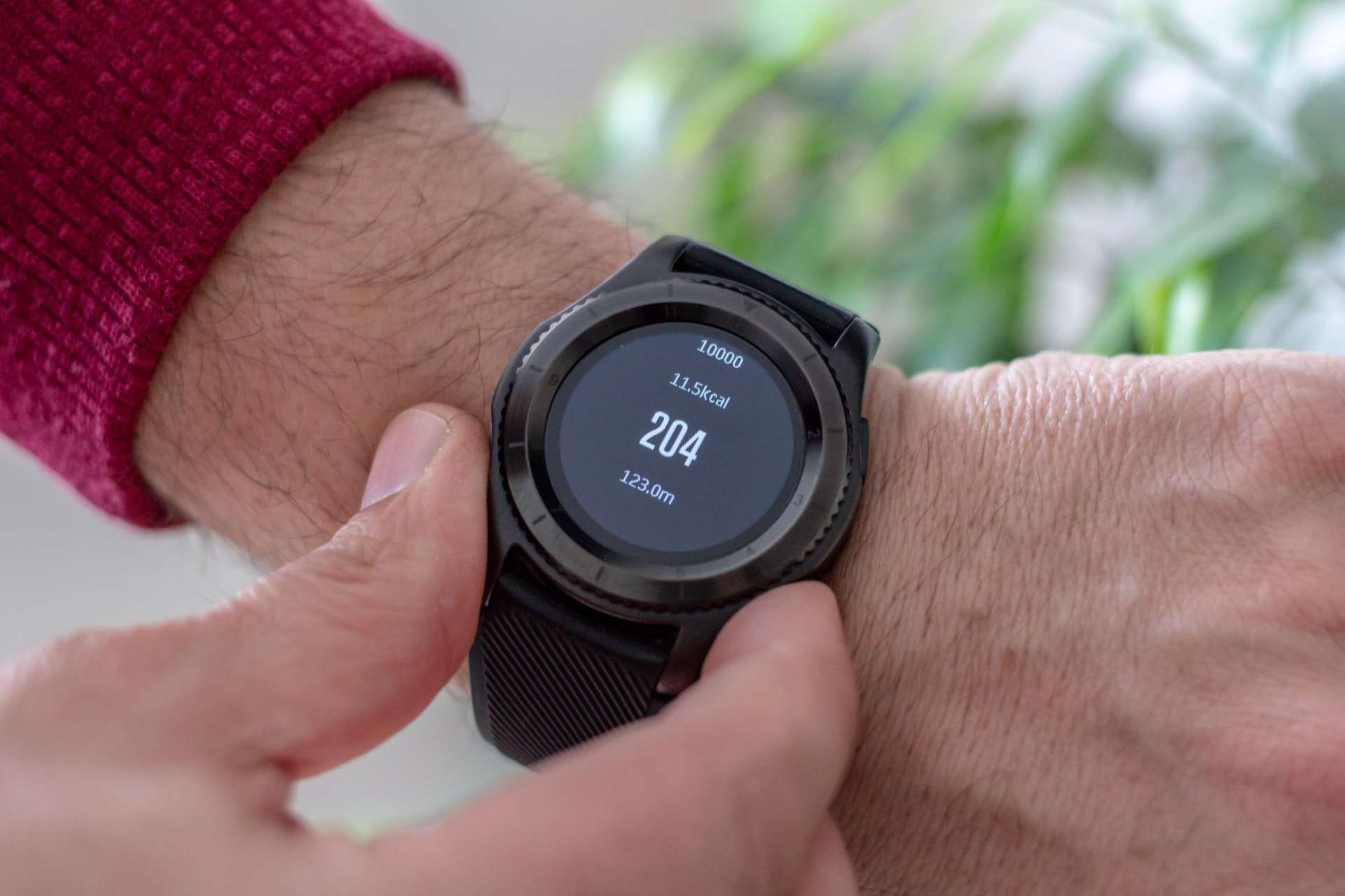 Person looking at Android smart watch