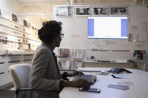 Businesswoman preparing presentation screen in office