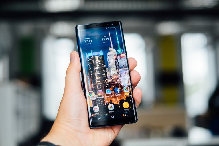 A Galaxy Note 8 held in a hand