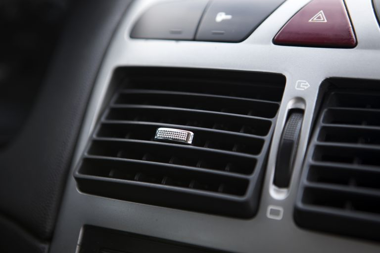 Close-up of heater on car dashboard