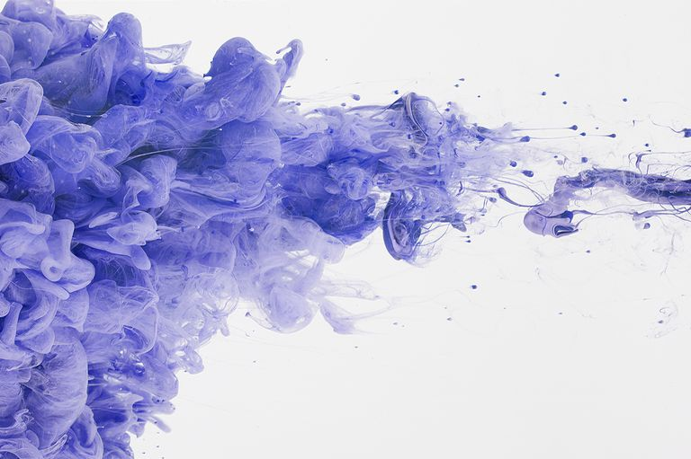 Cloud of purple ink in water