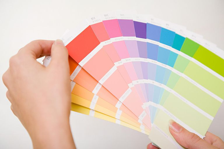 A person examining color swatches
