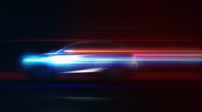 Futuristic view of a car driving fast and leaving light trails