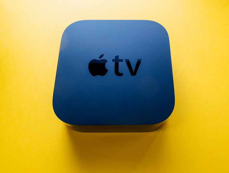 New Apple TV 4k console device against yellow background