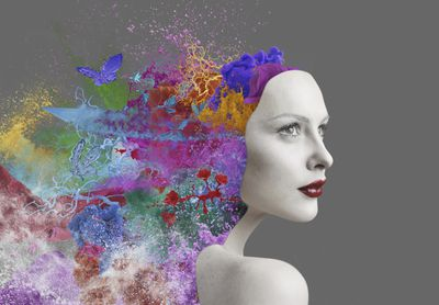 Visual effects of colors and butterfly figures coming out of the back of a woman's head