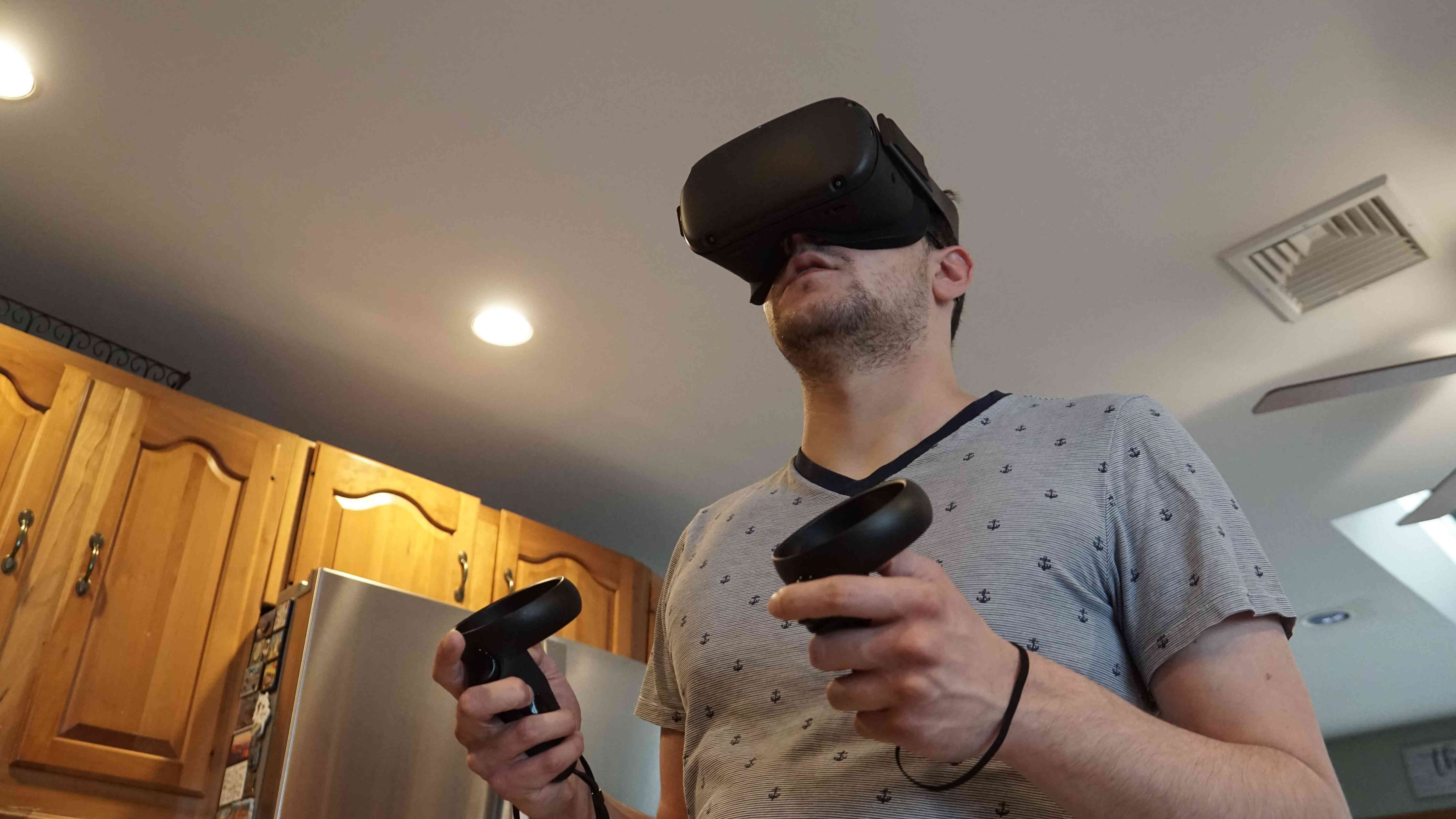 Person using Oculus Quest in their kitchen