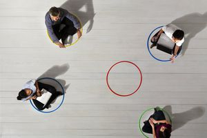 Colleagues sitting inside circles with one teammember missing