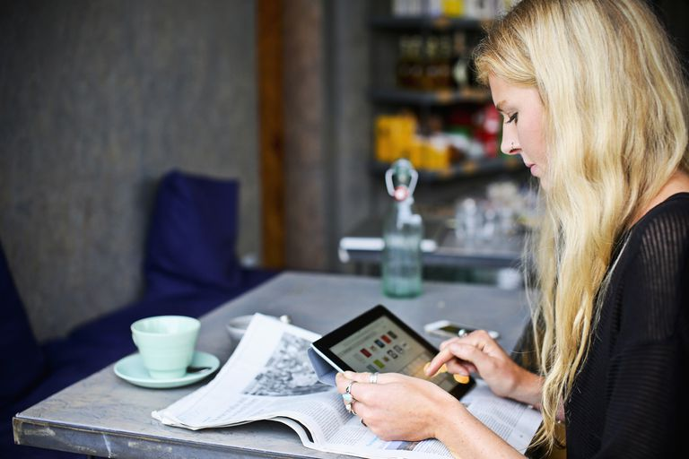 Reading a newsletter on a tablet
