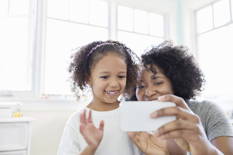 Woman and child on a video chat from a phone
