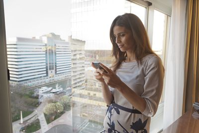woman checking iphone