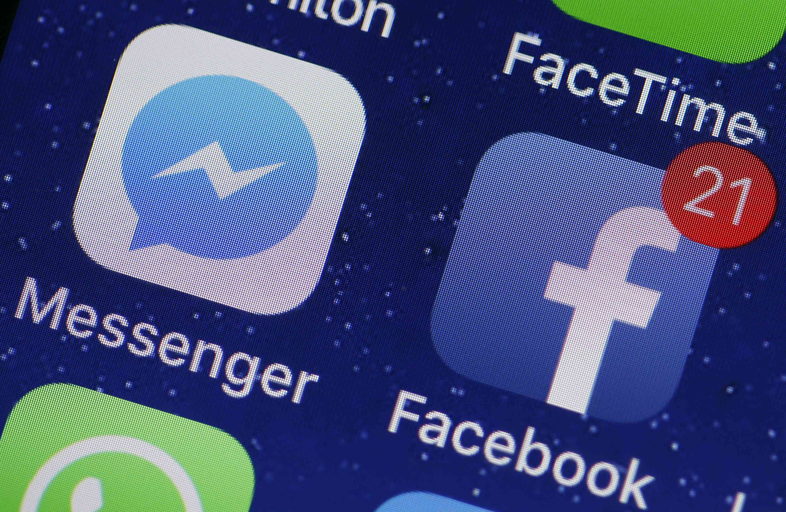 Messenger and Facebook icons on an iPhone