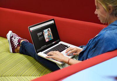 A woman working on a Flipboard Storyboard on a MacBook Pro.