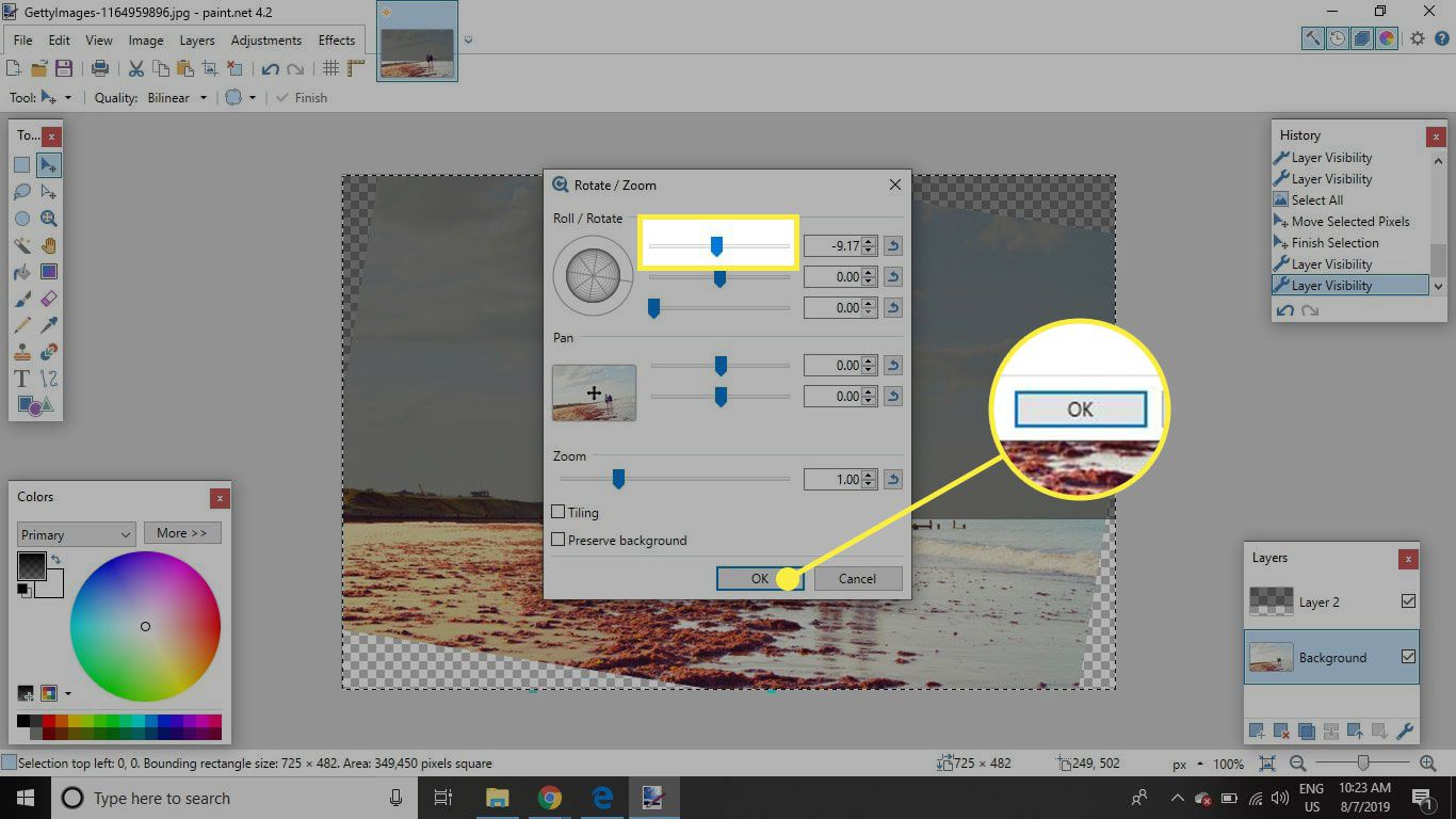 A screenshot of Paint.NET's Rotate/Zoom window with the top slider and OK button highlighted
