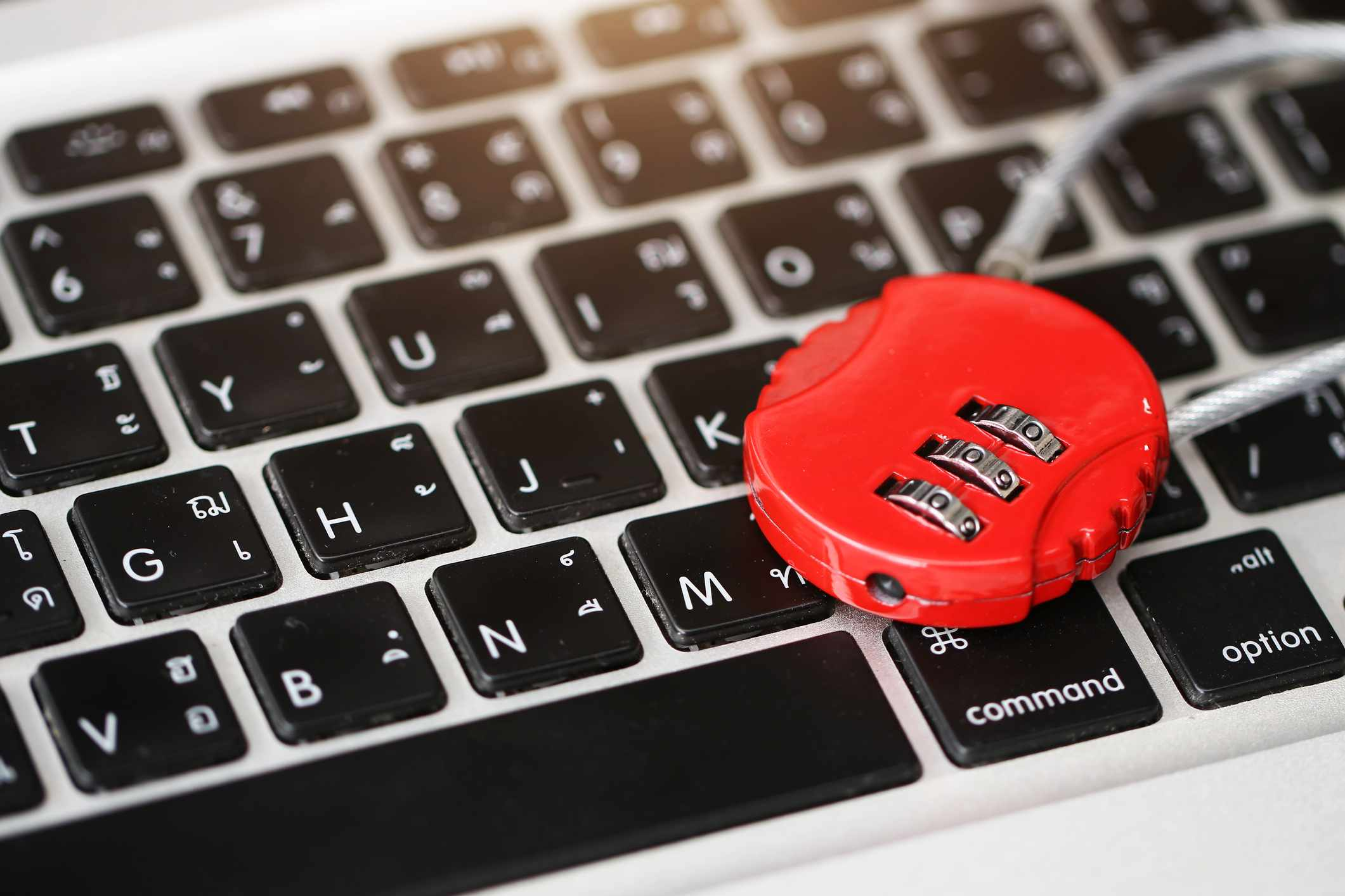 A lock on top of a laptop keyboard.