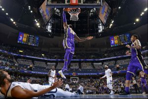LeBron James dunks in an NBA game.