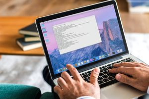 A man using the Terminal app on a MacBook Pro.