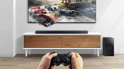 Samsung soundbar with gaming system and player with controller