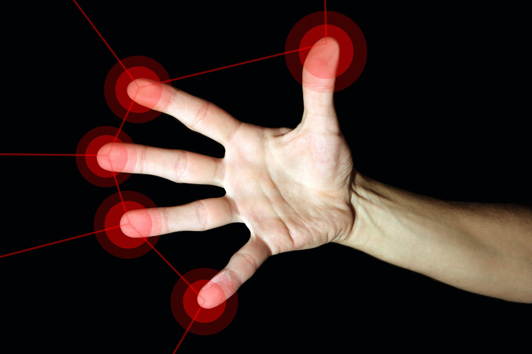 Photo of a hand with touchpoints and red lines on each finger to simulate a user interface