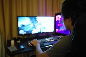 A woman playing a computer game.