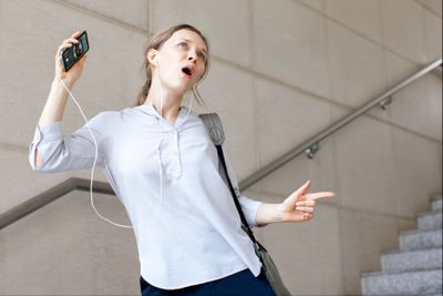 A student listens to Spotify on her phone.