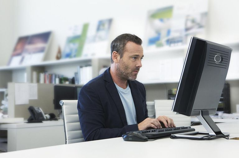 Man working on computer in small modern office