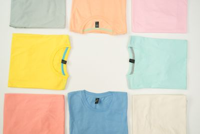 An image of colored T-shirts folded neatly.